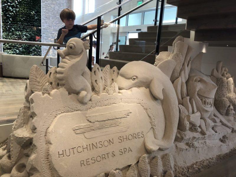 Child at Sand Sculpture at Hutchinson Shores Resort and Spa | Jensen Beach Florida | Florida family vacation | Florida hotels for kids| kid friendly hotel | Tips for family Trips | Mandy Carter | Florida Treasure Coast Vacation